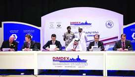 Dignitaries from Barzan Holdings during a signing ceremony with its international partners at Dimdex