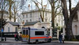 A police van drives into Kensington Palace Gardens as Russia's Embassy is seen behind, in central Lo