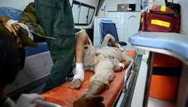 A Pakistani rescue worker gives medical treatment to injured blast victims in an ambulance following