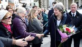 Britain's Prime Minister Theresa May (2R) meets members of the public during her visit to Salisbury,