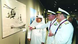 Katara's Ahmed al-Sayyed, Italian Navy chief Rear Admiral Valter Girardelli and another official vie