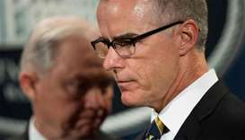 Acting Director of the Federal Bureau of Investigation (FBI) Andrew McCabe (R) and US Attorney Gener
