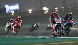 Moto drivers compete during the MotoGP qualifiers at the Losail International Circuit in Doha