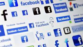 Shows logos of  social media and social networking service Facebook