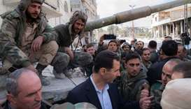 Syrian President Bashar al-Assad (C) talking with regime forces in Eastern Ghouta, in the leader's f