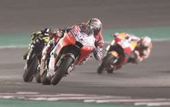 Dovizioso wins battle with Marquez in Losail thriller