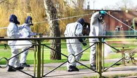 Personel leave after swabbing railings near a bench covered in a protective tent at The Maltings sho