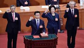 Newly elected Vice Premiers Hu Chunhua (L), Sun Chunlan (2nd R) and Liu He (R), led by Han Zheng (2n