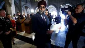 Canada's Defence Minister Harjit Sajjan leaves following a news conference