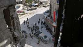 Syrian  forces gather at the main square of Kfar Batna, southeastern Ghouta