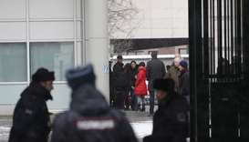 Members of the British embassy staff gather at its compound in Moscow, Russia