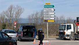 Three people killed in shooting, hostage-taking in France