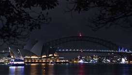 Sydney Harbour Bridge and the Opera House are plunged into darkness for the Earth Hour environmental