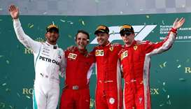 Motor racing-Opportunistic Vettel steals victory from Hamilton