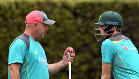 Australia's cricket coach Darren Lehmann (L) chatting with captain Steve Smith (R)