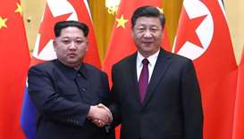 N Korea's Kim shows unity with China's Xi in first foreign trip