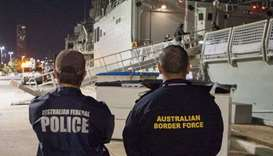 Australian Federal Police officer and an Australian Border Force officer