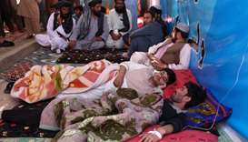 Afghan protesters lie as they receive Intravenous therapy (IV) drips during an hunger strike protest
