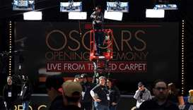 Workers and staff prepare the red carpet on the eve of this Sundays 90th Oscars ceremony, in Hollywo
