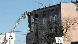 Four die in building collapse after explosion in Poland
