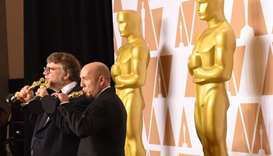 Director Guillermo del Toro (L) and producer J. Miles Dale with the Oscar for Best Film
