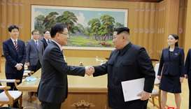 North Korean leader Kim Jong Un shakes hands with Chung Eui-yong who is leading a special delegation