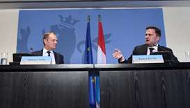 European Council President Donald Tusk (L) and Luxembourg's Prime Minister Xavier Bettel