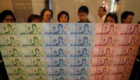 Thailand launches currency featuring new king's image