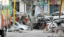 Damaged cars are seen at the scene where a suicide car bomb exploded targeting a Mogadishu hotel in