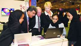 Dr Abdul Sattar al-Taie, Executive Director, QNRF, views a student's project at the exhibition.