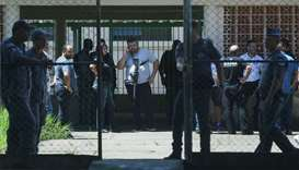 Policemen are seen at the Raul Brasil school after a shooting in Suzano, Sao Paulo state, Brazil