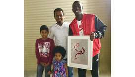 Almoeez Ali, football player, right, along with Abdul Kareem, centre, and his family.