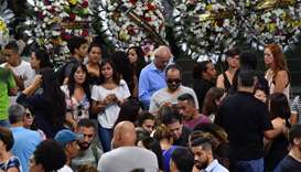 Relatives and friends of five victims of the Raul Brasil public school shooting pay their respects d