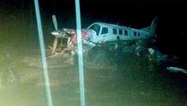 A small plane on an airstrip surrounded by floodwaters in Sentani, near the provincial capital of Ja