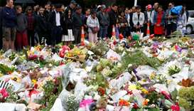 People pray for the victims of a shooting outside Al Noor mosque in Christchurch, New Zealand