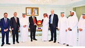 Qatar Chamber chairman Sheikh Khalifa bin Jassim al-Thani hands over a token of recognition to Leban