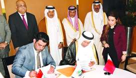 HE al-Kuwari witnessing the signing of a Memorandum of Understanding (MoU) between Qatar Polymer Ind