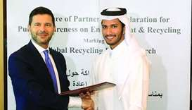 Italian ambassador Pasquale Salzano and EPR chairman Abdalla al-Suwaidi at the agreement signing yes