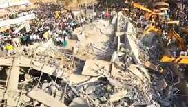 Two dead, dozens trapped, in India building collapse