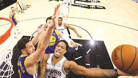 Spurs beat Warriors to extend streak, Nuggets in playoff