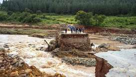 Workers stand stranded on a damaged road at Charter Estate, Chimanimani, eastern Zimbabwe
