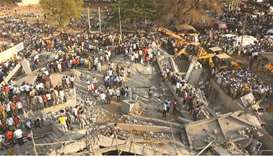 Two dead, dozens trapped in Dharwad building crash