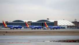 Southwest Airlines Co. Boeing 737 MAX 8 aircraft sit next to the maintenance area after landing at M
