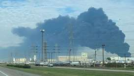 Smoke is seen rising from the Intercontinental Terminals Company (ITC) plant in the suburb of Deer P