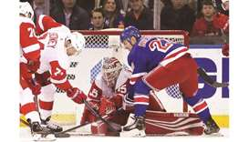 Red Wings top Rangers to open road trip