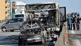 The wreckage of a school bus that was transporting some 50 children is pictured after it was torched