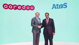 Ooredoo chief business officer Sheikh Nasser bin Hamad bin Nasser al-Thani shakes hands with Atos he