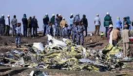 Ethiopian Federal policemen stand at the scene of the Ethiopian Airlines Flight ET 302 plane crash,