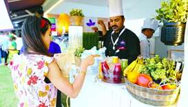 A festival goer points to some of the healthy offerings of Ideal Diet. PICTURE: Ram Chand.
