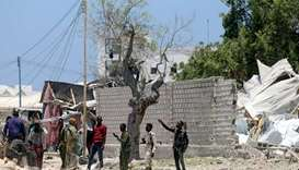 Somali security officers secure the scene after al-Shabaab militia stormed a government building in